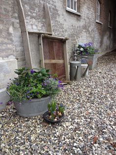 Image result for terracotta pots on pebbles
