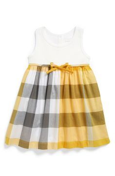 Such a playful little Burberry dress.