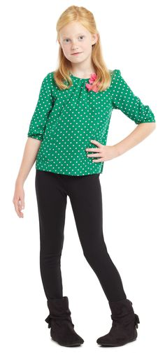I chose this outfit because I like the white dots with the green shirt.