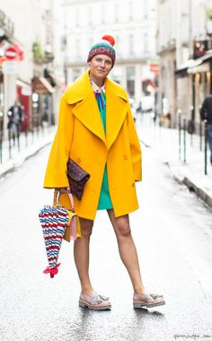 Elisa Nalin, Paris Fashion Week, yellow coat, turquoise dress, hat, umbrella, clutch, brogues / Garance Doré