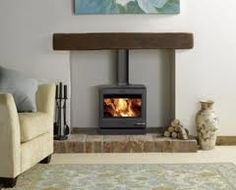 Wood burner with wooden mantle and brick base. , Wood burner with wooden mantle and brick base. Wood Burner Fireplace, Small Fireplace, Fireplace Hearth, Fireplace Ideas, Brick Fireplaces, Electric Fireplaces, Wood Stove Wall, Gas Stove Fireplace, Corner Fireplaces