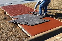 Brick Concrete Stamp - a really beautiful way to make plain concrete sidewalks look like brick walkways. I want to do this to our sidewalk!