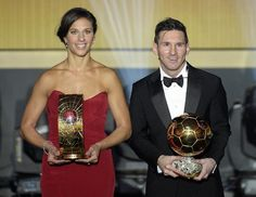 Carli Lloyd of the USA and Argentina's Lionel Messi pose with their trophies after winning the FIFA soccer player of the year 2015 prize during the FIFA Ballon d'Or awarding ceremony at the Kongresshaus in Zurich, Switzerland, Monday, January 11, 2016. (Walter Bieri/KEYSTONE via AP))