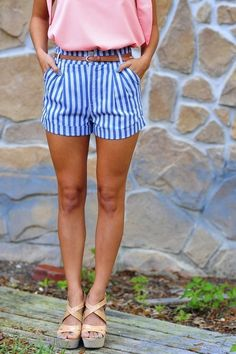 Pink shirt with blue and white striped shorts and nude strappy wedges.