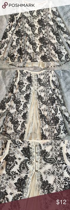 NWOT Rewind top Gorgeous top! Cream with black, faded black and gray paisley designs. Button detail at back with lace inset panel. NWOT. Rewind Tops Blouses