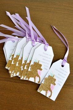 Our Confetti Momma Unicorn Thank You Tags 10CT can be such a cute way to wrap up a small thank you for your guests. Tie together your unicorn party favors with these personalized thank you tags for an unforgettable favor that your guests are sure to enjoy! This product was made using a high quality white cardstock embellished with a gold glitter cardstock unicorn cutout paired with luxurious lavender satin ribbon. Size of each tag: 4 H, 2 W Unicorn size: 2.25H x1.75W Quantity: 10 Gift Tag...