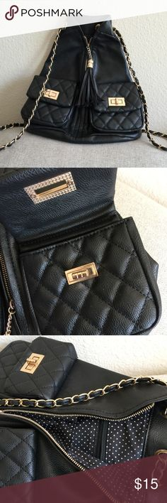 Faux Leather Fashion Mini Backpack Black pebbled faux leather and gold tone  hardware with tassel zipper , 2 front pockets and one inside Bags Backpacks