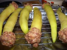 Banana peppers stuffed with sausage, put in a pan, cover with tomato sauce and cheese, bake and enjoy!