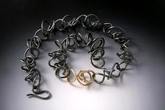 """Wrapped Kinetic Necklace""  Gold & Silver Necklace    Created by Rina S. Young  $598.00"