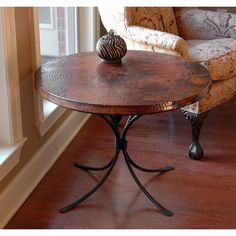 Hammered copper and wrought iron table.