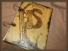 Squirrel tail and ogham letterig to this A4 journal