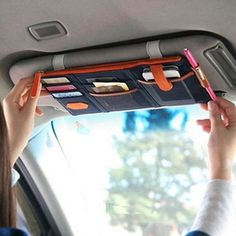 Multiple pockets are right at your fingertips with this Sun Visor Organizer. You'll have a large, zippered compartment, slots for your parking access and other cares, a place for your phone, your pen