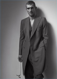 Will Chalker models a double-breasted coat and suit by Bottega Veneta.