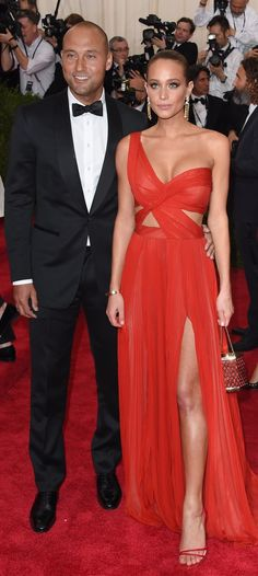 Hannah Davis and Derek Jeter hit up the red carpet at the CFDA Awards. Hannah wore a sexy red J. Mendel gown, complete with a leg slit, and finished her look with complementing statement accessories.