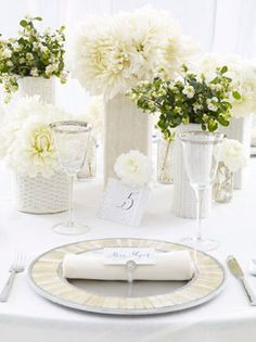 Simple white centerpiece with mixed vases - this is really pretty!