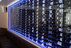 like bc it's multi purpose - mood lighting (like the blue color), wine storage & wall art Wine Cellar Modern, Glass Wine Cellar, Home Wine Cellars, Wine Cellar Design, Wine Design, Wine Cava, Caves, Cave A Vin Design, Wall Hanging Wine Rack