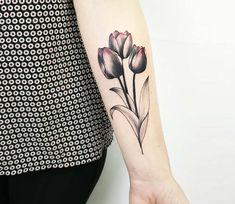 Three tulips tattoo by Simona Merlo