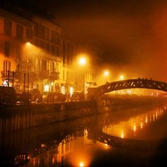 .@travelandleisure | A nighttime glimpse at the navigli, a system of five interconnected canals in #Milan. #Italy #bridge Read more at http://web.stagram.com/p/433524887414797576_178377460#VMtdOEHOAUcxC2yt.99