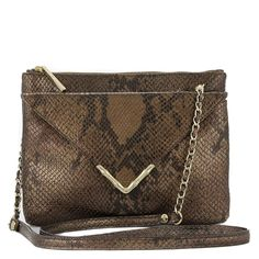 Bailey Chocolate Python Crossbody Your fall wardrobe won't be complete without Bailey. This versatile, chocolate embossed snakeskin bag m akes the transition to fall effortless and fashionable. Bailey features an envelope front closure that sits in front of a zip pouch, ensuring plenty of room for day to night.
