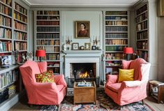 Room of the Day ~ salmony-pink slipcovers in this blue-gray library with patterned rug in English library 5.14.2015