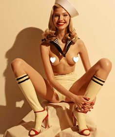 Gorgeous Russian Suoermodel Sasha Luss is Miss August for this years iconic Pirelli Calendar, Shot by Steven Meisel and Styled by Carine Roitfeld. Sasha wears Syrens latex Varsity Socks. http://www.syren.com/latex-stockings-lingerie-p-528-varsity-socks.aspx