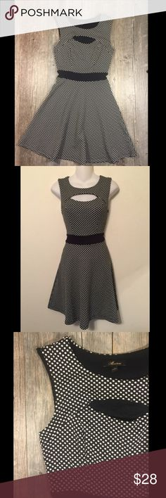 Black and white polka dot fit and flare dress Black and white polka dot fit and flare dress. Peephole in bust. 35 inches long. Polyester 4% spandex. Tag reads small. Dresses
