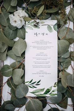 Elegant reception menu and lush garland table decor | Image by Kaoverii Silva  #reception weddingreception #weddingreceptioninspo #receptioninspiration #receptiondecor #receptioninspo  #finishingtouches #weddingdecor #tablescape #menu #weddingmenu