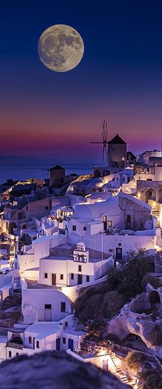 Greece Travel Inspiration - Beautiful full moon in Santorini, Greece.