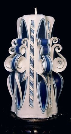 Candle is approximately 2 pounds and stands 8 inches high. Rendered in dark and light blue to white matching tapers are available at a reduced cost (see tapers).This and all Ribbon Candles can be made in your choice of colors when you order. With careful burning votive votives candles