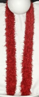 Red boa yarn hand loomed.  Wear as a scarf or add a brooch for an infinity scarf look.  60 in. long