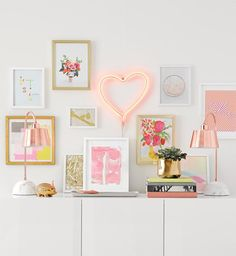 When planning your gallery wall, choose your pieces from mixed media — typography prints, art prints, paintings, illustrations, photographs, neon lights and more.