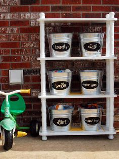 Genius idea for keeping outdoor toys organized -- store them in galvanized bucke. Genius idea for keeping outdoor toys organized — store them in galvanized buckets labeled with ch Do It Yourself Organization, Garage Organization, Garage Storage, Organization Ideas, Organizing Toys, Organized Garage, Bathroom Organization, Outdoor Toy Storage, Outdoor Toys