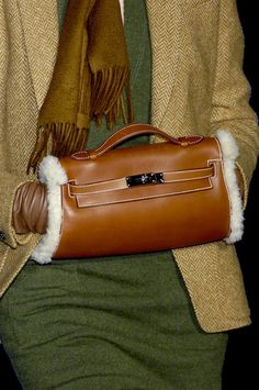 You know... because an Hermes birkin muff is very practical.