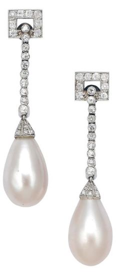 An Art Deco Pair of Natural Pearl and Diamond Ear Pendants, Chaumet, circa 1920 Suspending a pair of natural pearl drops measuring approximately 14.5 mm by 9.0 mm, from geometric surmounts and flexible lines and caps accented by round and rose-cut diamonds, mounted in platinum, maker's mark for Joseph Chaumet.