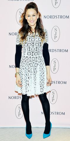 To promote her shoe collection at Nordstrom, Sarah Jessica Parker made her lace LWD work for cooler weather by pairing it with a black long-sleeve top and tights. A smattering of jewelry, including layered necklaces, and teal pumps from her SJP line rounded out her look.