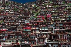 Larung Gar monastic complex is a Tibetan area in China but the architecture is strikingly similar to the one of favelas in Rio. Here 8-10,000 monks and nuns study Tibetan Buddhism.