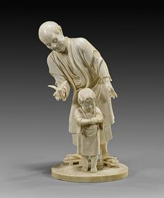 "Japanese Tokyo School carved ivory figural group; of a man holding out a bird in his hand, to a young boy standing in front; late 19th Century; signed; H: 8 5/8""; Provenance: from the Estate of Zoltan Shaw, collected in the mid 20th Century"