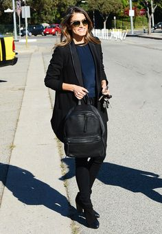 Black and navy with a leather backpack.