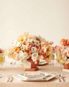 Modern Centerpiece  Table arrangements for your wedding that feature roses. Romantic Majolica, garden, and spray roses make contemporary centerpieces when juxtaposed with geometric terra-cotta pots.