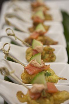 Squash blossom fritters filled with house smoked salmon and a dollop of achiote aioli #horsdoeuvres #catering