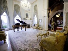 This mansion's music and performance room, adjacent to and open to the library, is an airy and lofty space decorated in a classical manner that evokes a French baroque style.