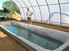 Tilapia Pond - Interesting... aquaponics, 4000 gallon tank in the middle of his green house will hold 2000 Tilapia, the water will be used to water his plants giving them needed nutrients. The heat from the pond will warm the greenhouse in winter.