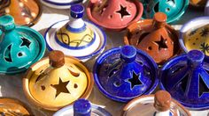 The souks of Morocco are home to an endless number of gems; don't forget to pick up colourful tagines like these before you leave.  Photo: Martin Norris travel Photography / Alamy Stock Photo  #travel #shopping #souvenirs #Morocco #Africa #markets #colours
