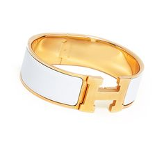 Clic-Clac H Hermes wide bracelet. White enamel. Gold plated hardware, 2.25 diameter, 7.5 circumference, 1 wide.