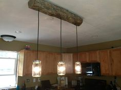 DIY cabin light fixture- A new rustic twist on Mason Jar Light fixture from Pottery Barn. We used a log from the area, but you could use reclaimed lumber.or many other fun options. Cute with log furniture, car siding, knotty pine or rustic cabin decor.