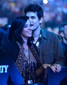 Katy Perry and John Mayer cozy up at the Rolling Stones concert. See more on Wonderwall: http://on-msn.com/XncJc0