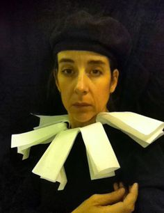 """""""To pass time during long flights, artist Nina Katchadourian goes to the lavatory, adorns herself in tissue paper costume, and creates hilarious self-portrait photos in the style of Flemish Renaissance paintings. She calls the series 'Seat Assignment: Lavatory Self-Portraits in the Flemish Style.' """""""
