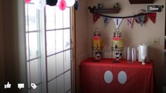 Mickey and Minnie Mouse themed drink station.