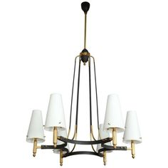 Elegant six-light chandelier made in Milan, 1955. The piece is credited to Arredoluce. Its form reveals beautiful craftsmanship and has white opaline blown glass shades on a black lacquered frame.