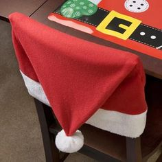 Santa Hat Chair Covers- These would be soo cute for my Christmas tablescape